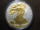 1 Dollar 2004 USA USA Silver Eagle 2004 Gilded BU gilded  49,00 EUR  zzgl. 3,95 EUR Versand